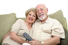 Older couple watching TV