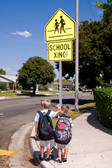 Two children at a school crossing